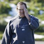 Patriots coach Bill Belichick watched his team practice yesterday.